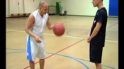 how_to_improve_your_basketball_skills_how_to_dribble_a_basketball_between_the_legs