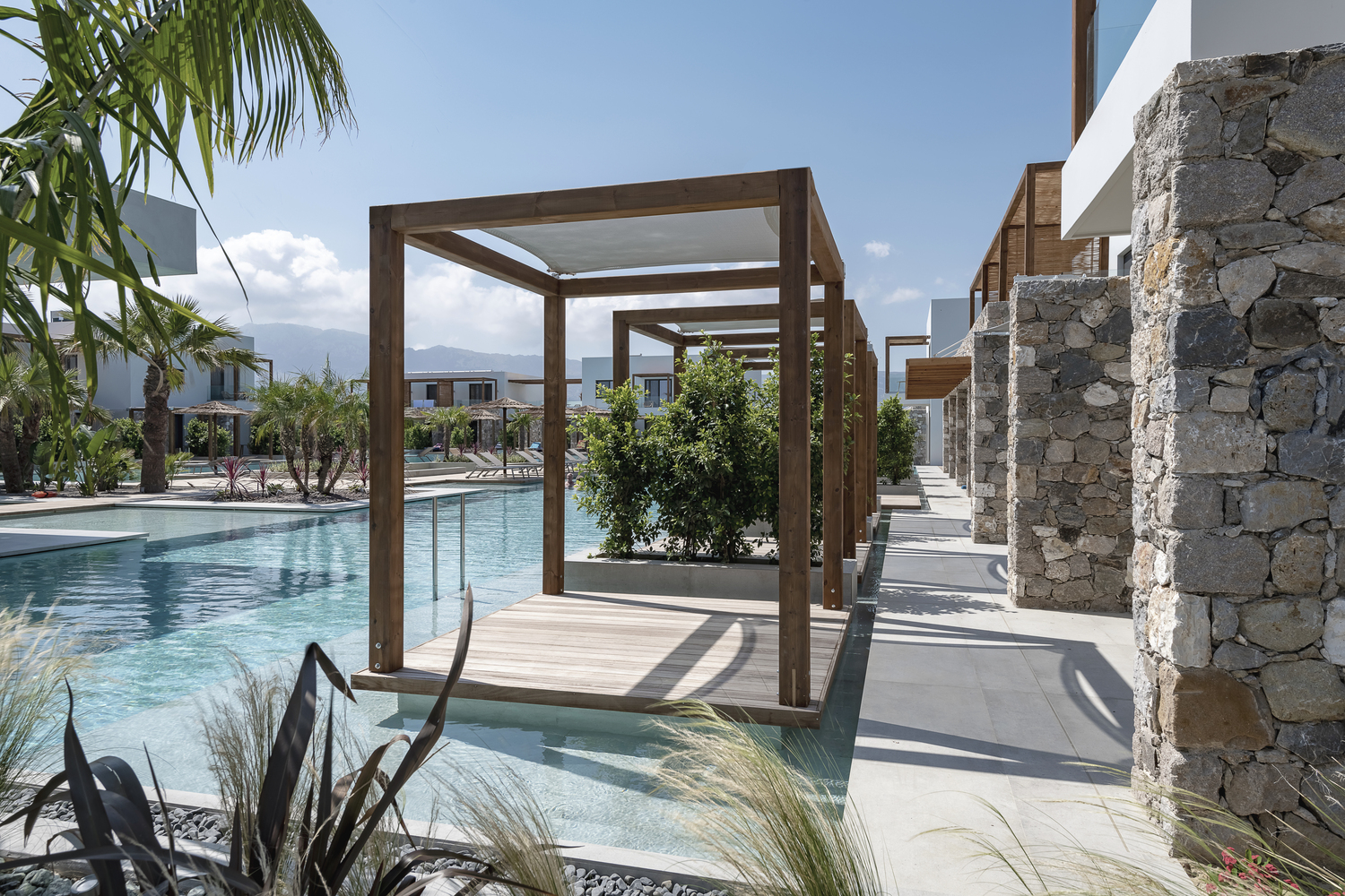 Caravia Beach Junior Suites & Restaurant / Mastrominas ARChitecture